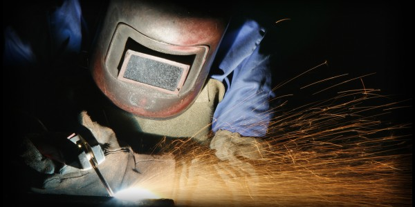 Welding sheet metal into tubes in an engineering workshop